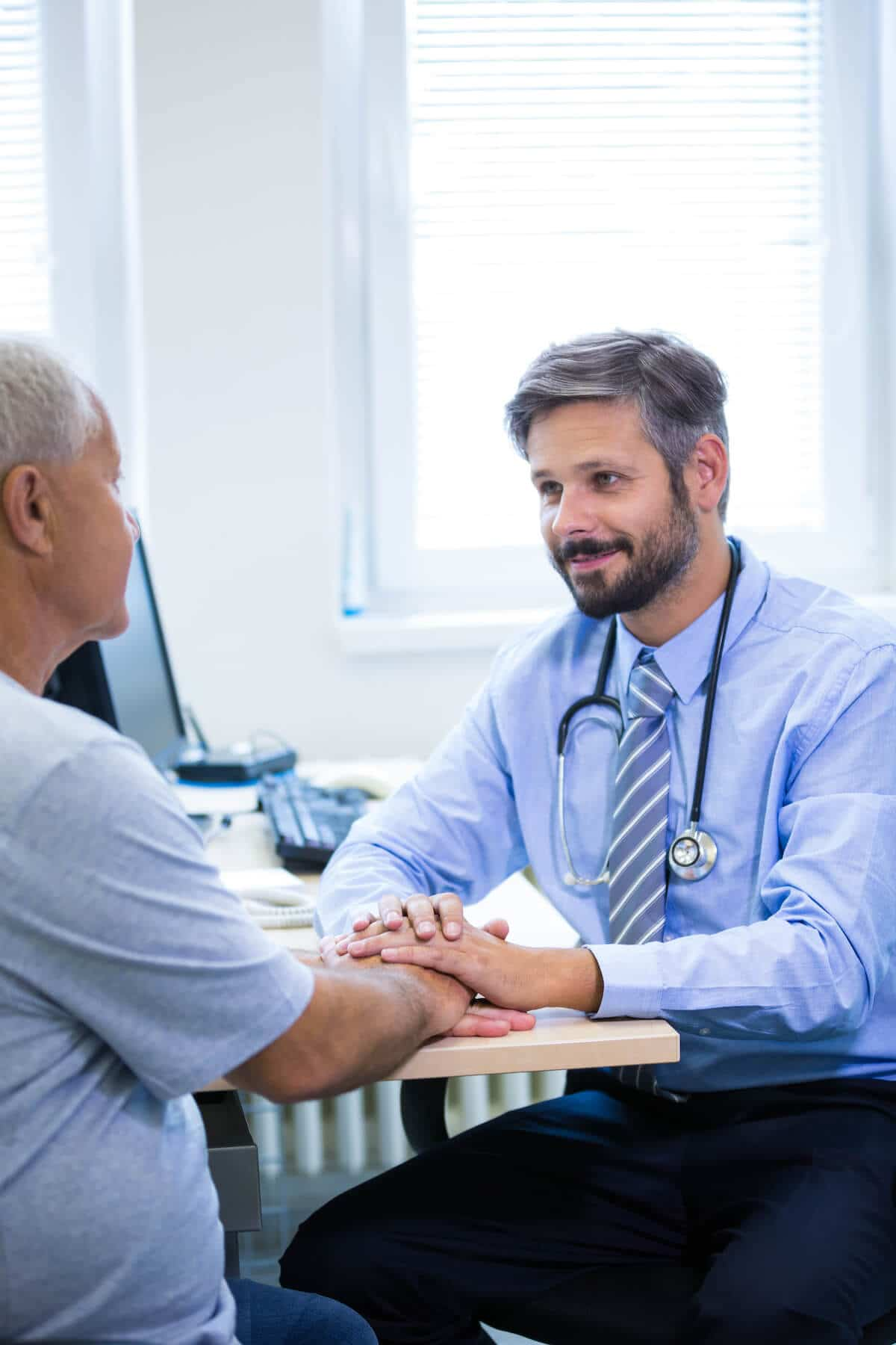 male doctor consulting with patient